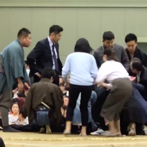 Japan sumo chief apologizes after female medics was asked to leave ring